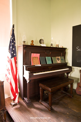 Old Piano and American Flag at Red Brick School, Washington County, Iowa