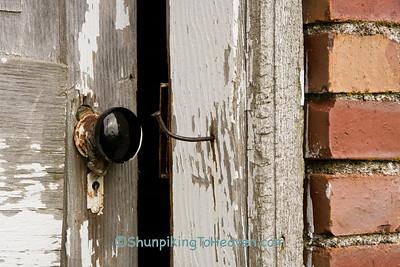 Black Porcelain Doorknob on Outhouse Door, Jones County, Iowa