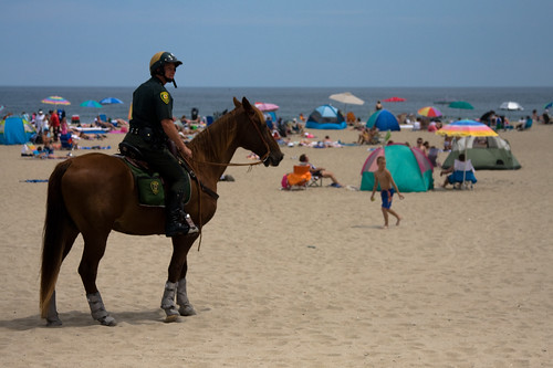 police on horse patrolling Hampton Beach