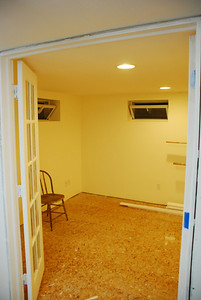 View looking from the laundry area into the living room