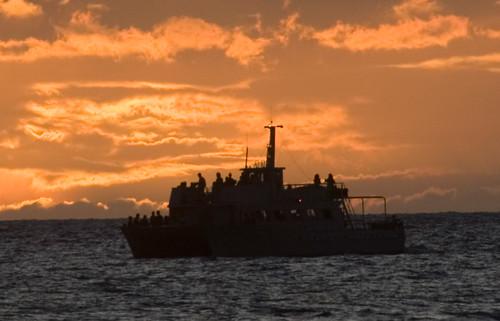 Boat at sunset off Lahaina, Maui, Hawaii