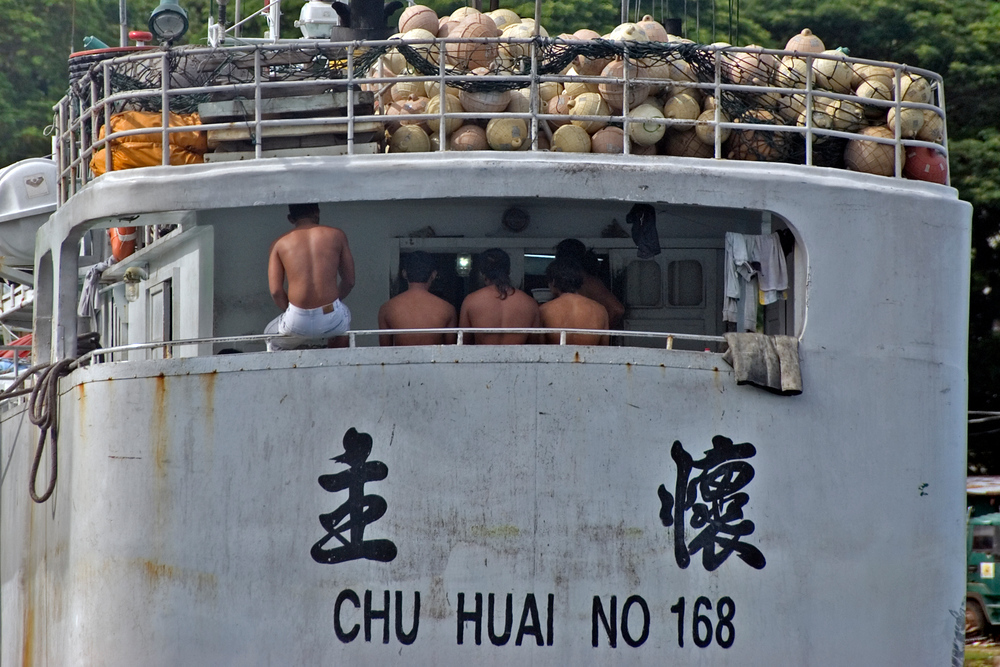 Chinese sailors waiting on board their boat