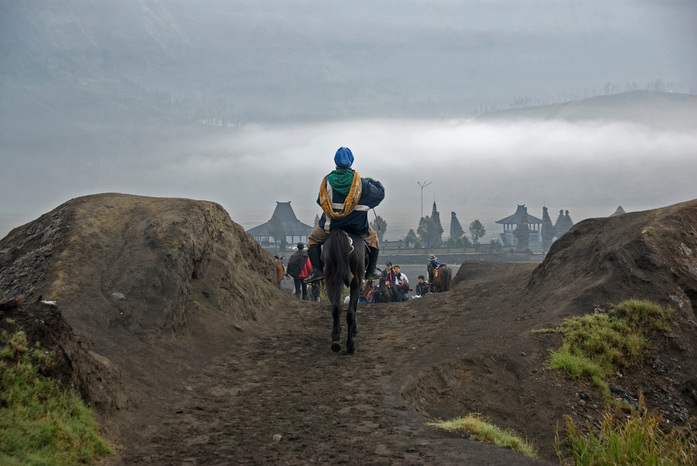 Man on horse at Mount Bromo, Indonesia