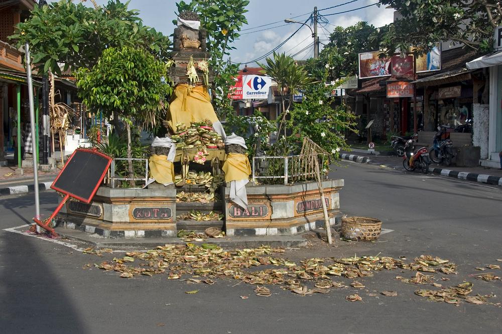 Balinese offerings (Canang Sari) at Kuta roundabout
