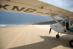 Plane landing on the beach