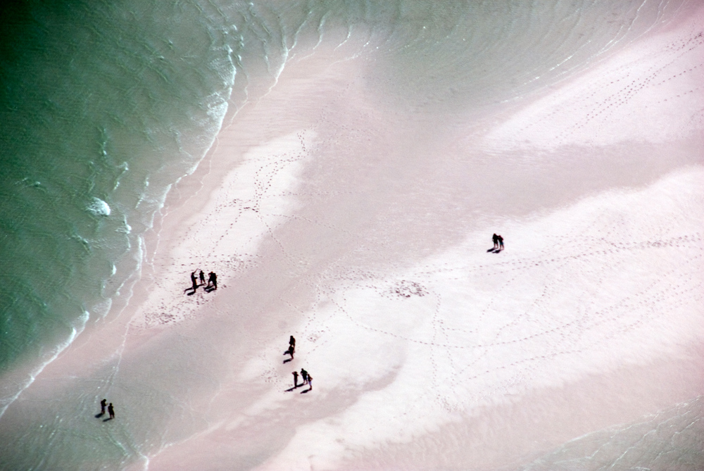People on 4 mile beach, Whitsunday Islands, Queensland, Australia