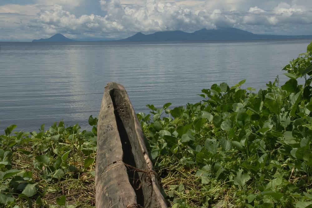 Canoe and volcanoes. Papua New Guinea