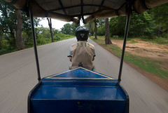 The view from the back of a tuk-tuk. The driver is Bhin