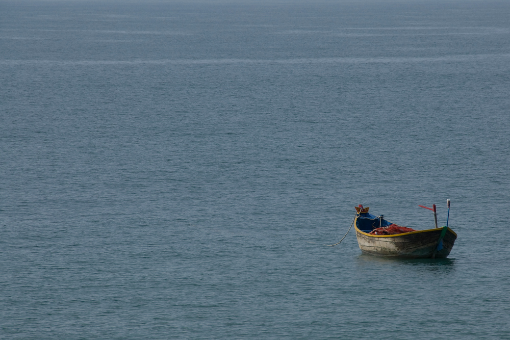 Boat in water. Mui Ne, Vietnam