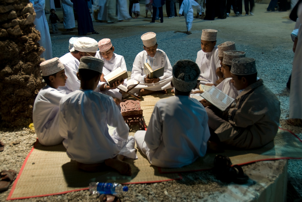Boys studying the Koran, Muscat, Oman