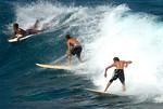Surfers off Hookipa Beach, Maui