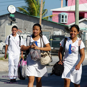 Walking to school in San Pedro town.