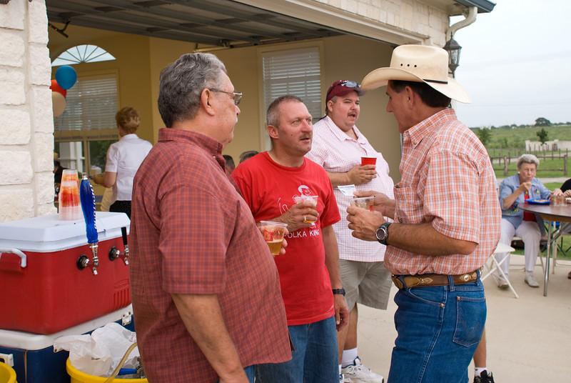 Lawrence Wisnoski, Bernie Kroll and Mike Kurtin socializing at the beer keg.