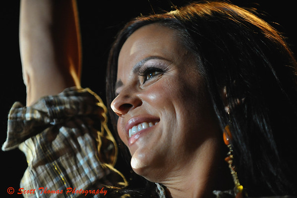 Sara Evans waving to the audience after finishing a song during her concert at the New York State Fair on August 27, 2009.