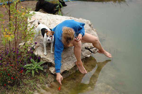 Cynthia Utterback aka: IDPbyCU petting the goldfish by the stream in front of her house.