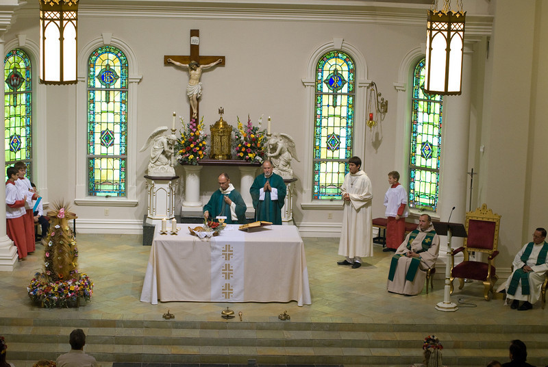 Monsignor Slawomir Oder incensing the altar during mass in Our Lady Of Czestochowa church