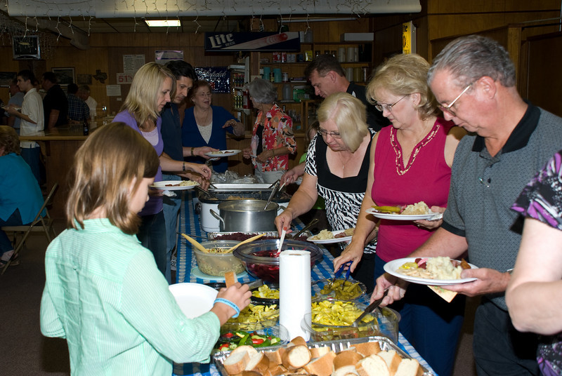 The crowd enjoys the abundance of good food.