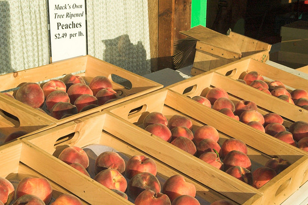 These Peaches are in Home Made pine crates made to keep them from being damaged.  Save the paper bag (upper right) you can use it to ripen  them if needed.