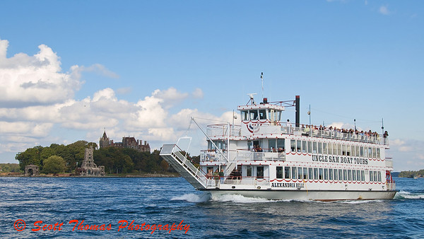 Uncle Sam Boat Tours cruiser the Alexandria Belle taking out a group of tourists to the 1000 Islands near Alexandria Bay, New York.
