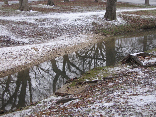 The creek under the bridge framed by ice (167_6734)
