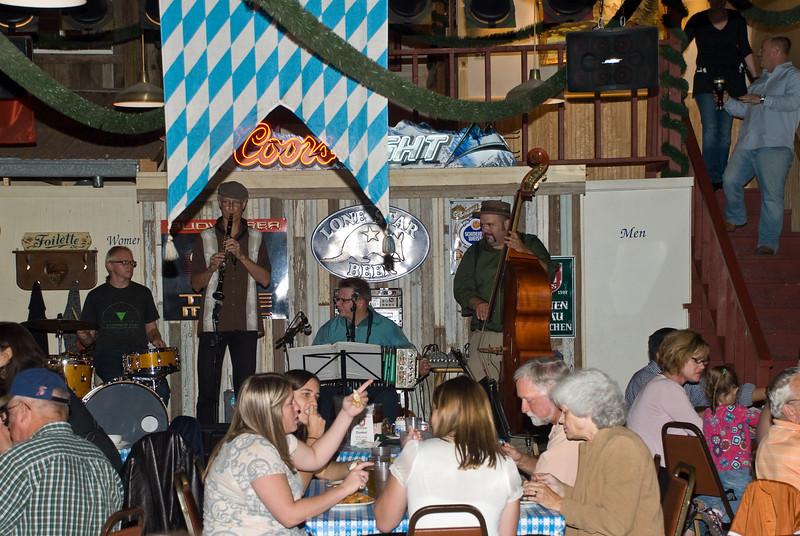 The large dinner crowd enjoys the Polish music at Wahlburg Restaurant