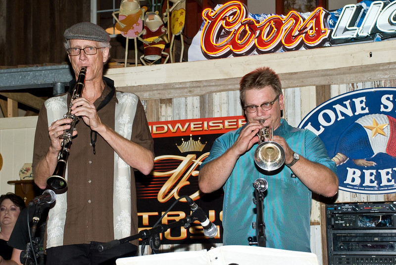 Tim Walsh and Bradley Jaye Williams playing horns