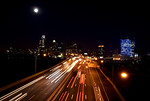 Cars zipping along the Schuykill Expressway with the Philadelphia Skyline in the background