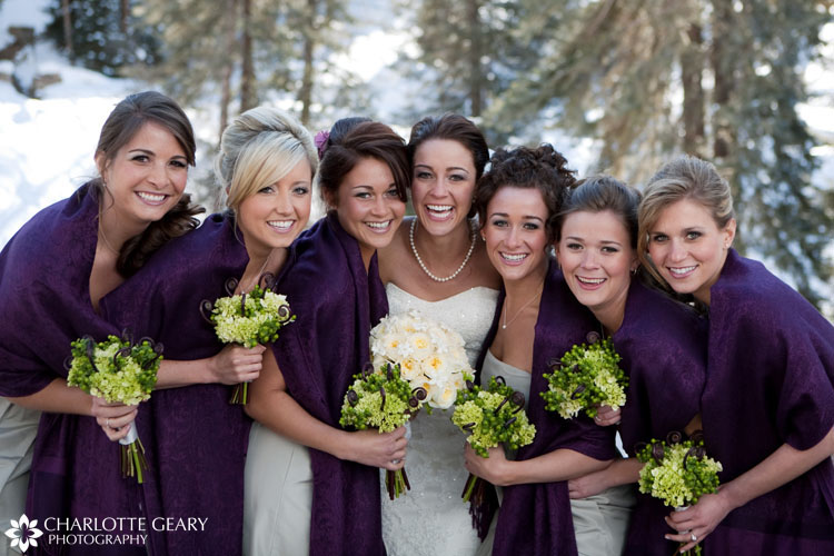 Bridesmaids with purple shawls and green flowers