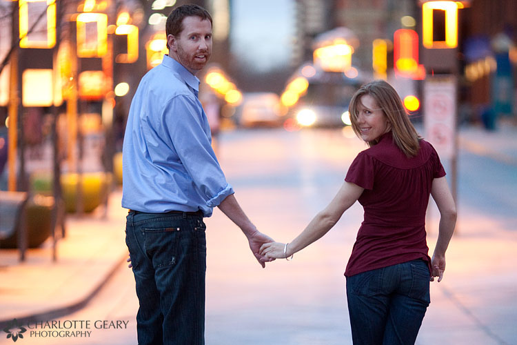 Nighttime engagement portraits in Lower Downtown Denver