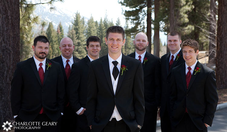 Groomsmen in black suits with red ties