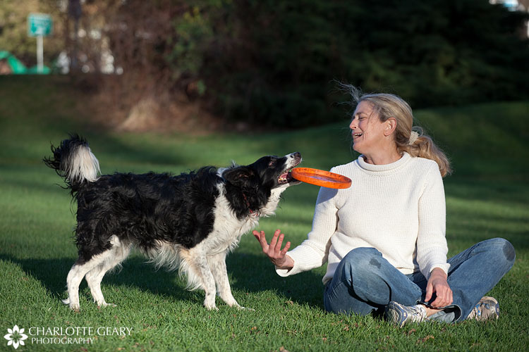 Woman and her dog playing frisbee