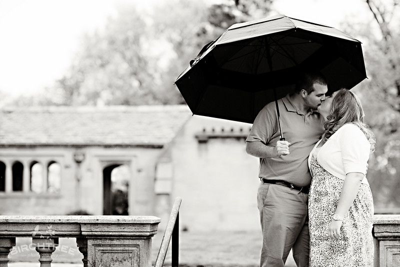 rainy engagement photo at hartwood acres