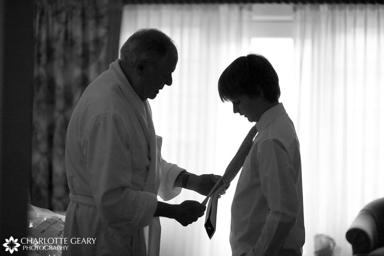 Grandfather and grandson getting ready for wedding