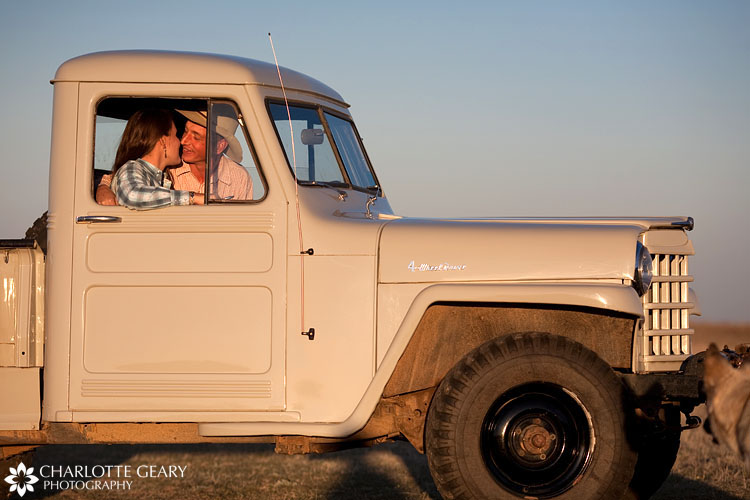 Engagement portrait in an antique truck