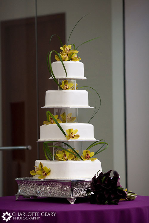 Four-tier square wedding cake with orchids
