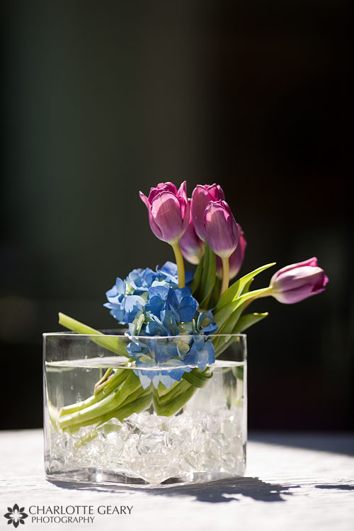 Centerpiece with purple tulips and blue hyacinth