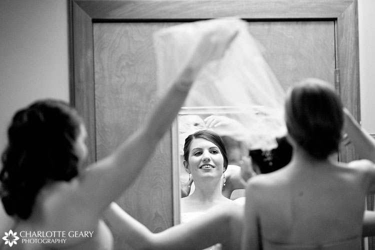 Bride putting her veil on