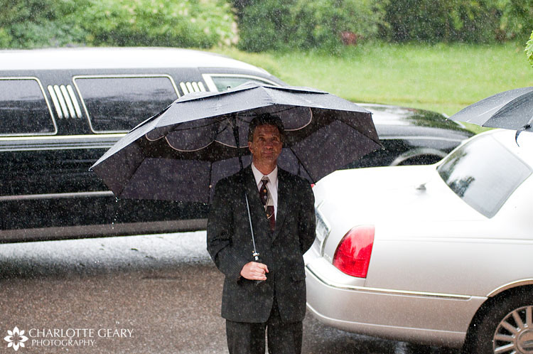 Limo driver in the rain