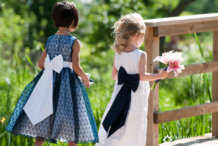 Flower girl in navy blue dress
