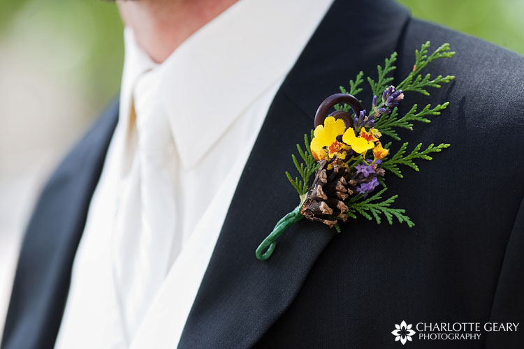 Groom's boutonniere with pine cone