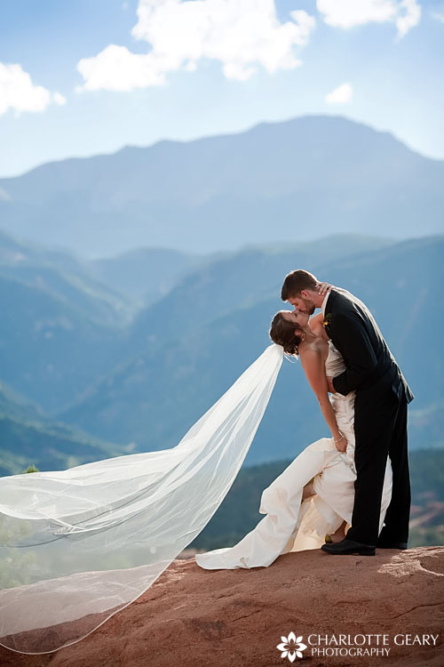 Bride and groom in front of Pikes Peak