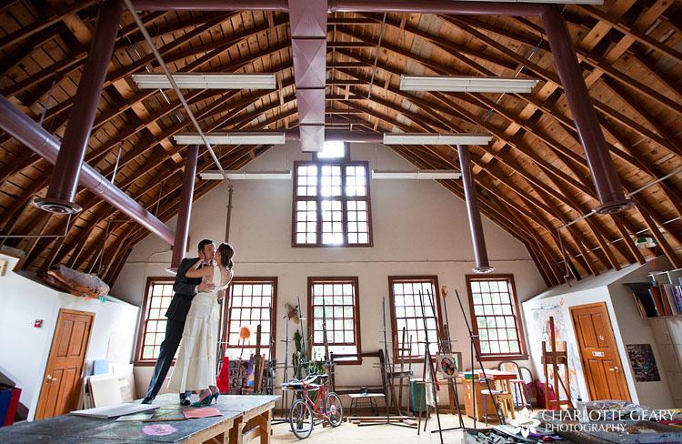 Bride and groom in art studio