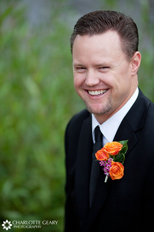 Groom in orange boutonniere