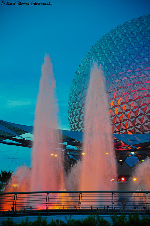 Epcot's Innovention Fountain with Spaceship Earth in the background at dusk in Walt Disney World, Orlando, Florida.