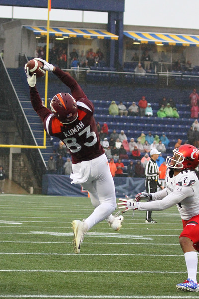 Virginia Tech wide receiver Eric Kumah makes a leaping catch