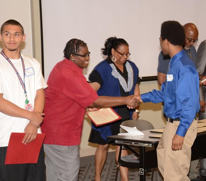 867_Irene_Price_congratulates_Honorees_1413x1242.jpg
