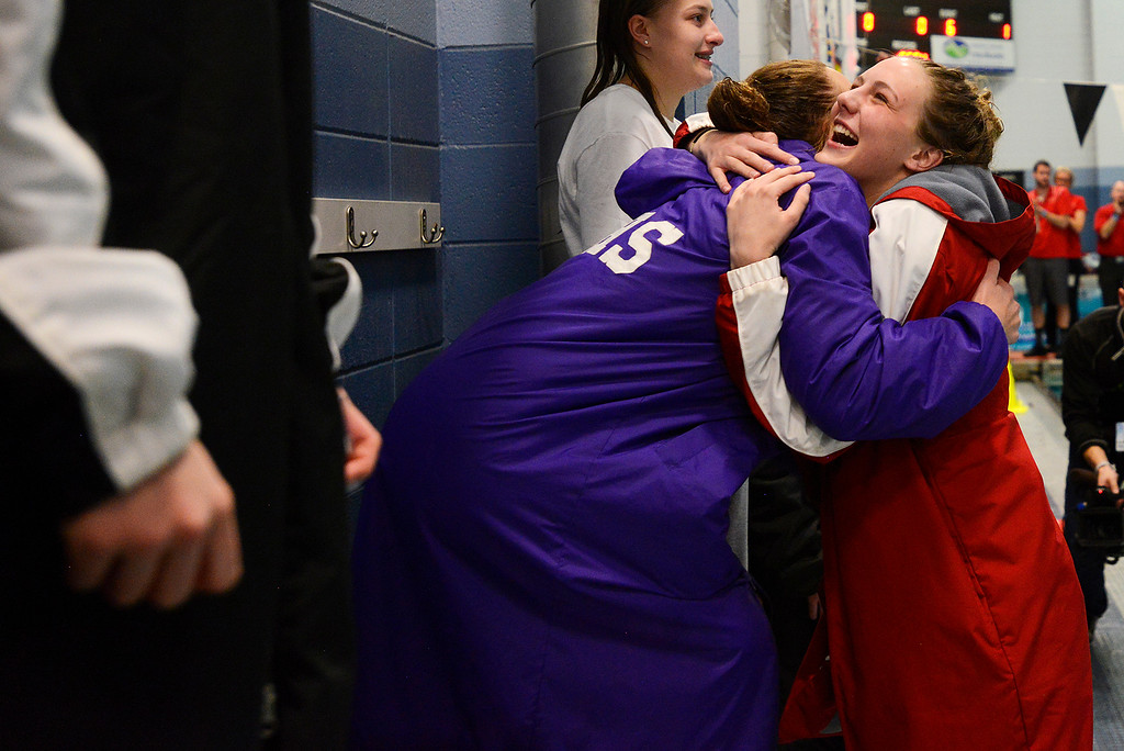 . Regis Jesuit\'s Mckensi Austin is congratulated on the way to the podium after finishing first in the diving competition of the girls 5A State Swim meet held at Edora Pool and Ice Center on Saturday. (Photo by Kira Horvath/ The Denver Post)
