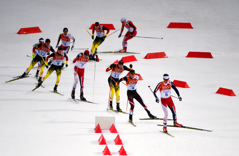 . Joergen Graabak of Norway leads the pack in the Nordic Combined Men\'s 10km Cross Country during day 11 of the Sochi 2014 Winter Olympics at RusSki Gorki Nordic Combined Skiing Stadium on February 18, 2014 in Sochi, Russia.  (Photo by Lars Baron/Getty Images)