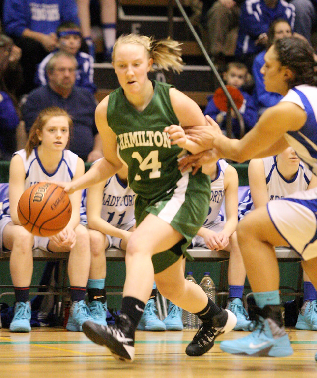 . Hamilton\'s Tenna Wilcox  (14) brings the ball down court  as a Ft Edwards player defends in the first half of the NYSPHSAA Class D semifinal in Troy on Saturday, March 15, 2014.JOHN HAEGER-ONEIDA DAILY DISPATCH @ONEIDAPHOTO ON TWITTER