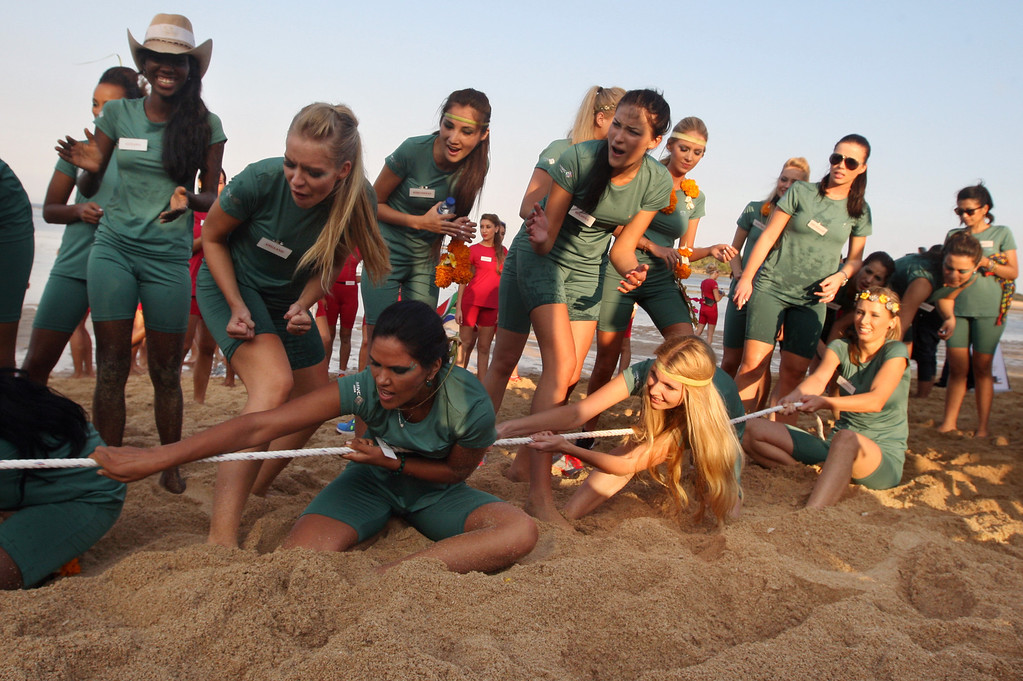 . In this Tuesday, Sept. 10, 2013 photo, contestants of Miss World 2013 pageant play a tug of war during a beach game session in Nusa Dua, Bali, Indonesia. Beauty queens and backstage drama may seem inevitable, but at this year\'s Miss World competition, something more serious than hair-pulling and name-calling has come from host country Indonesia: Muslim hardliners have threatened to hijack the competition despite major concessions from the government and organizers. (AP Photo/Firdia Lisnawati)